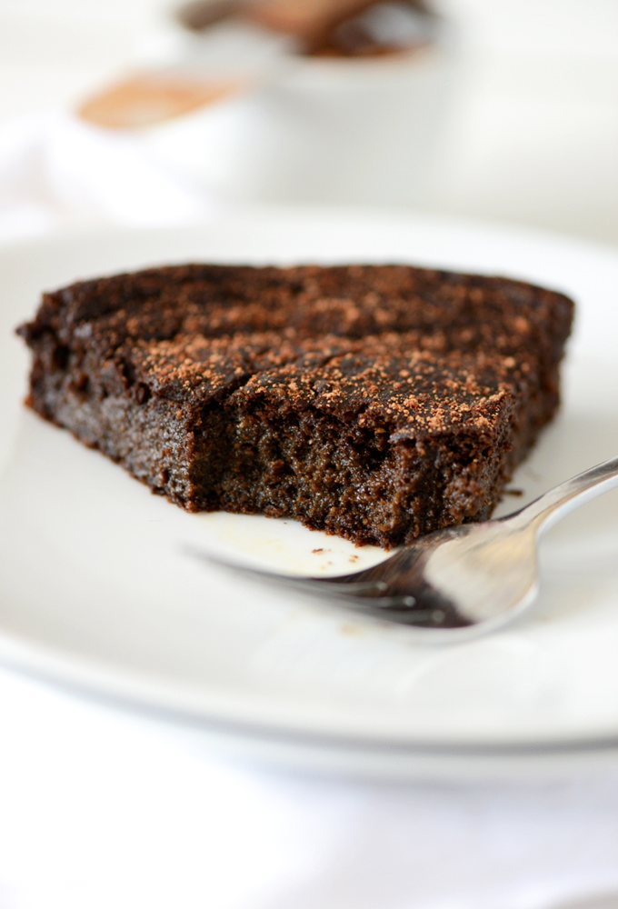 Plat with a slice of Fudgy Gluten-Free Chocolate Cake