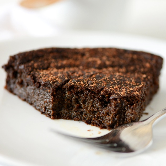 Slice of Fudgy Gluten-Free Chocolate Cake with a bite removed