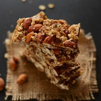 Cascading stack of Vegan Granola Bars made with almonds and oats