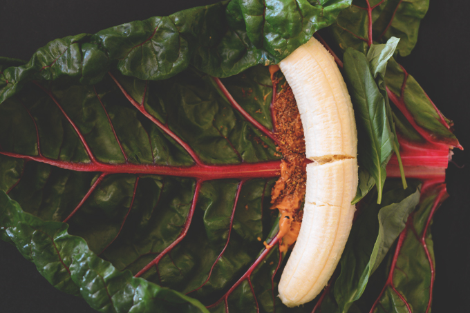 Peanut butter and banana on a rainbow chard leaf