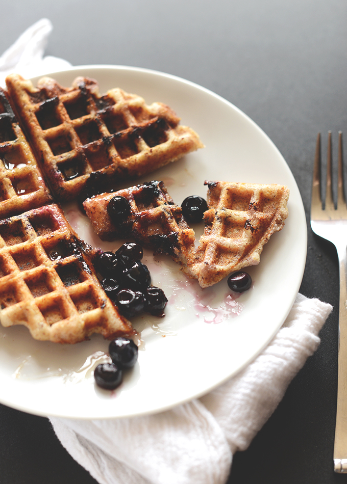 Plate with a Gluten-Free Blueberry Lemon Waffle topped with extra blueberries