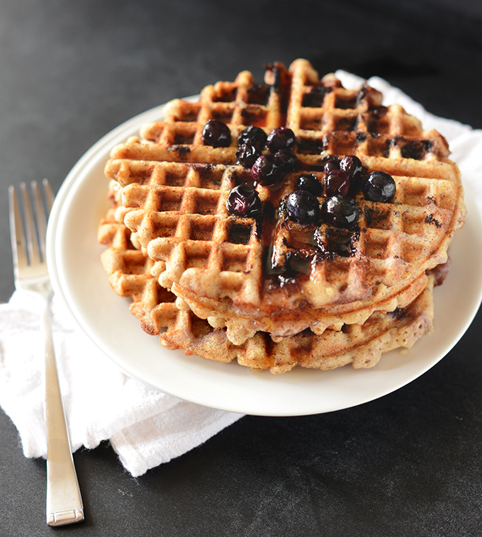Stack of gluten-free waffles topped with blueberries