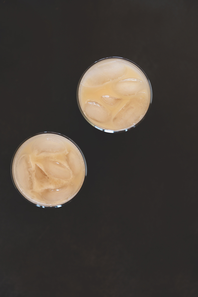 Top down shot of two glasses of our Vegan Boozy Horchata recipe