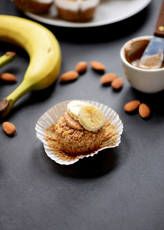Banana Almond Meal Muffin topped with almond butter and sliced bananas