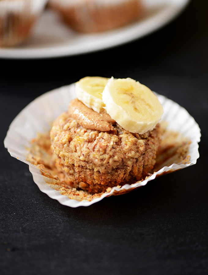 Close up shot of a Banana Muffin topped with almond butter and banana