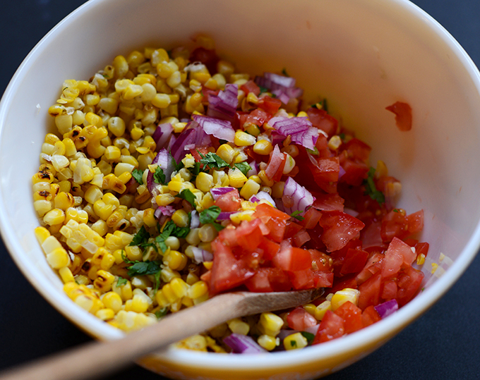Bowl of ingredients for making our Grilled Corn Salsa recipe