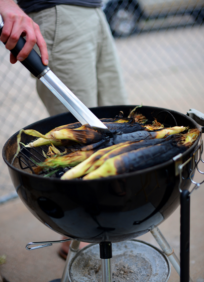 John grilling ears of corn