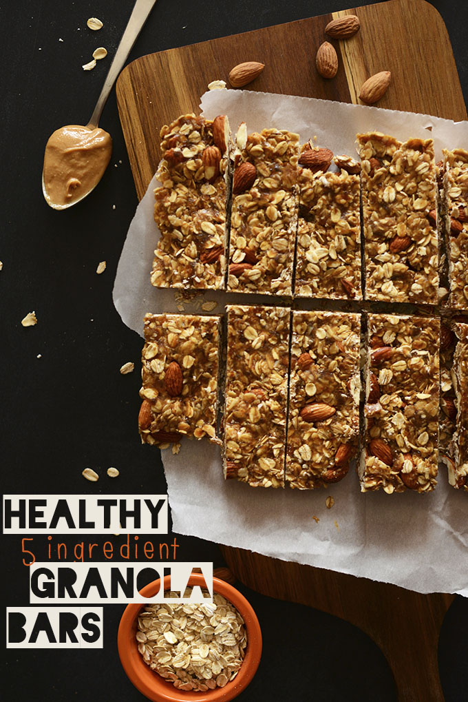 Batch of Healthy 5-Ingredient Granola Bars on a parchment-lined cutting board