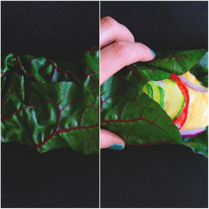 Holding a Hummus Rainbow Chard Wrap