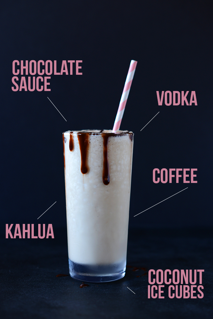 Indicating kahlua, coconut ice cubes, and other ingredients in our Vegan White Russian recipe