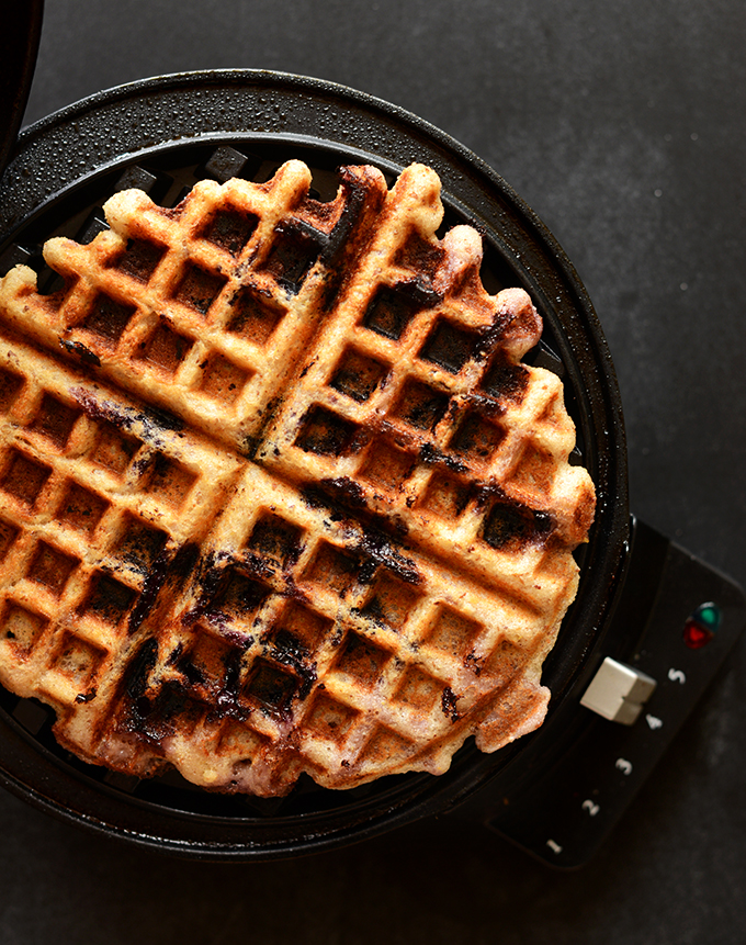 Cooking a Lemon Blueberry Gluten-Free Waffle in a waffle maker