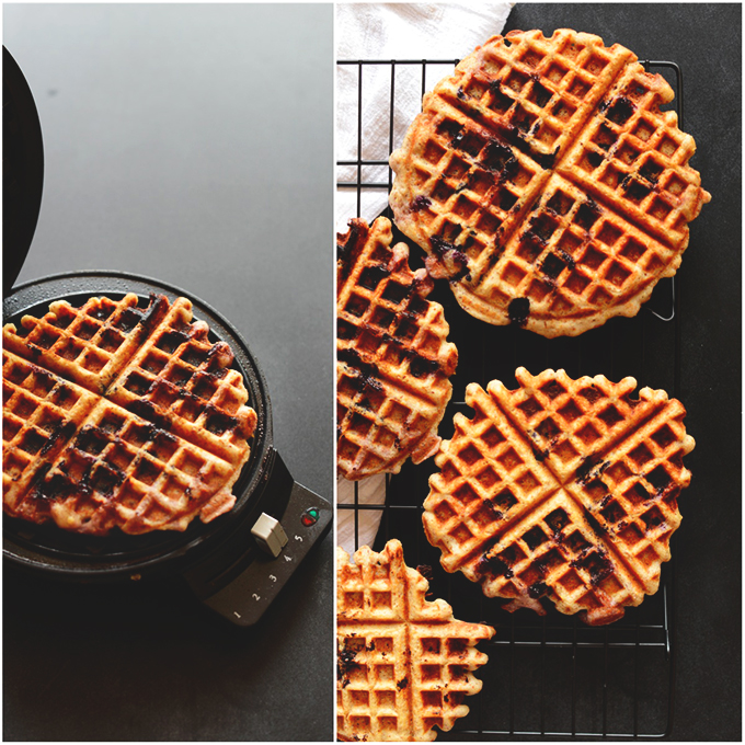 Waffle maker and cooling rack holding Lemon Blueberry Gluten-Free Waffles