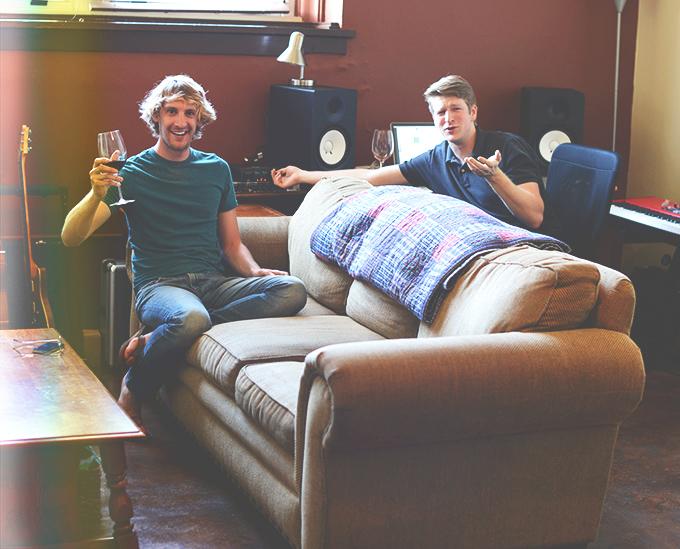 John and Ben chatting and enjoying wine