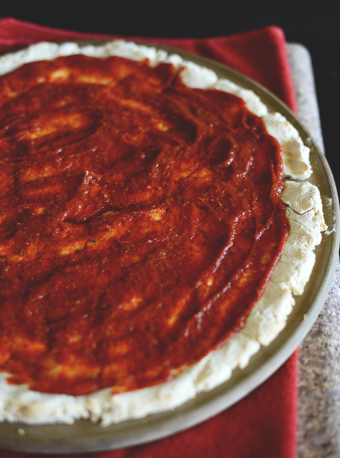 Homemade pizza crust spread onto amazing Gluten-Free Pizza Dough