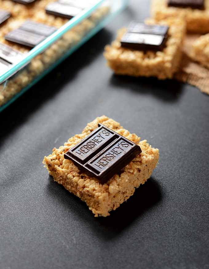 Close up shot of a Smores Rice Crispy Treat topped with Hershey's Chocolate