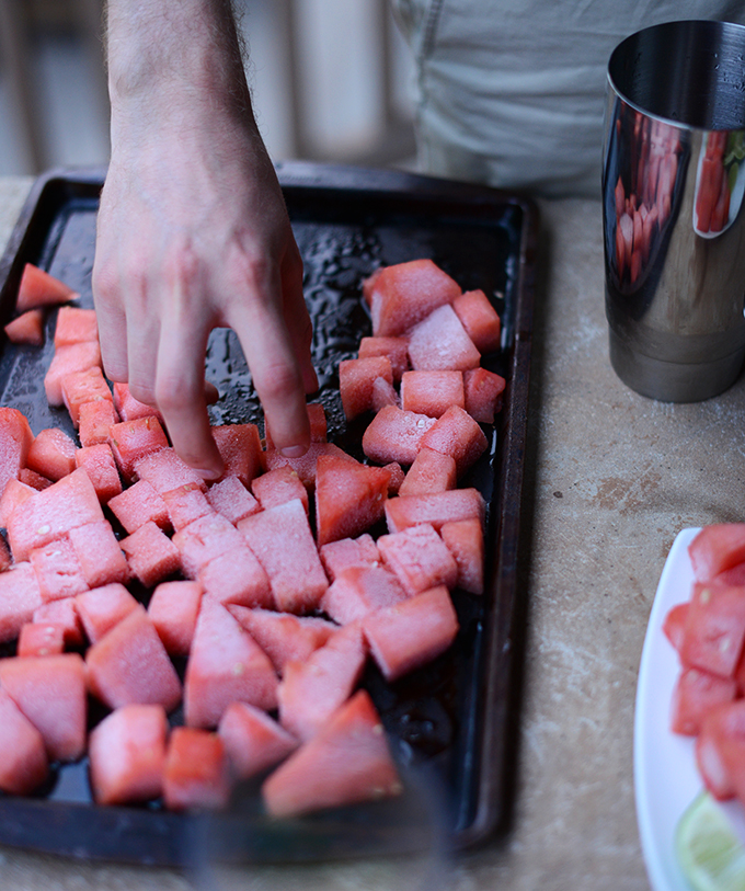Grabbing a handful of watermelon ice cubes to add to homemade margaritas