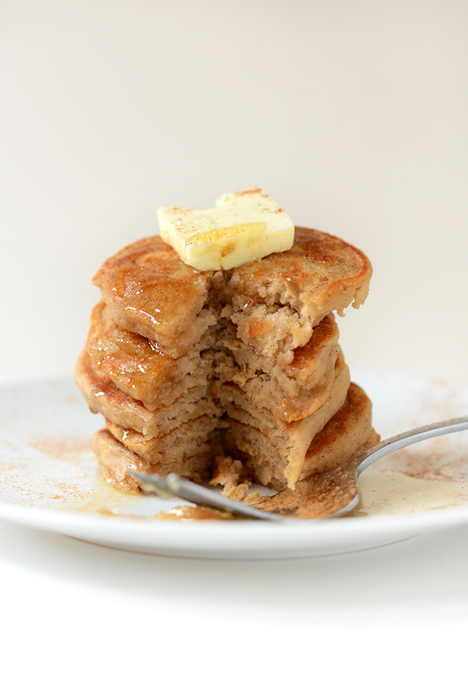 Stack of Fluffy Dairy-Free Sopapilla Pancakes with a slice removed