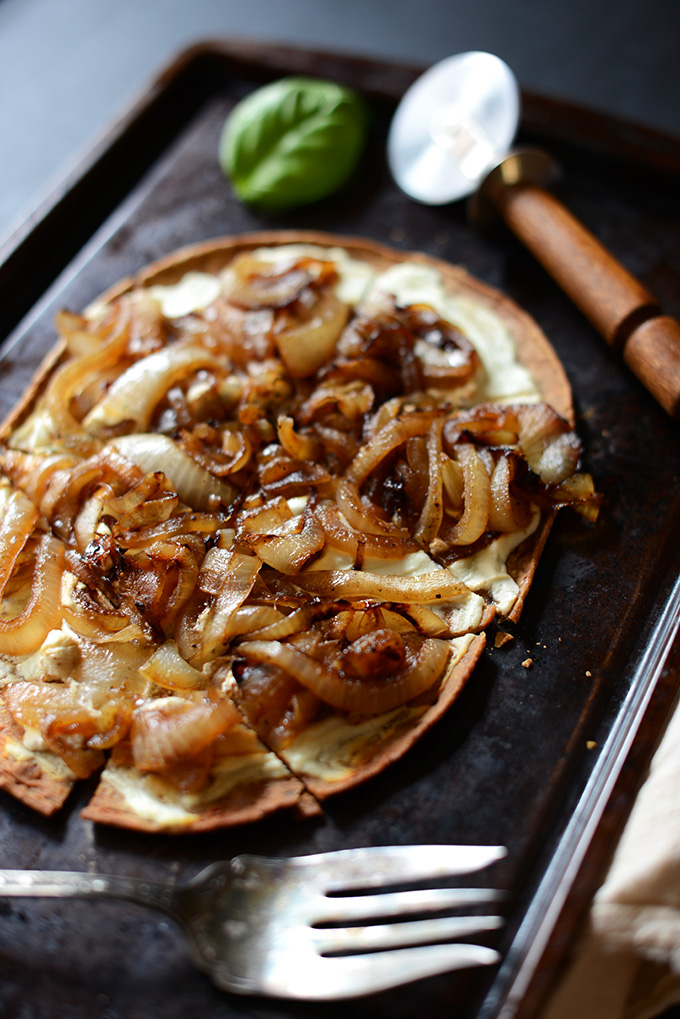 Baking sheet with slice Goat Cheese and Caramelized Onion Vegetarian Pizza