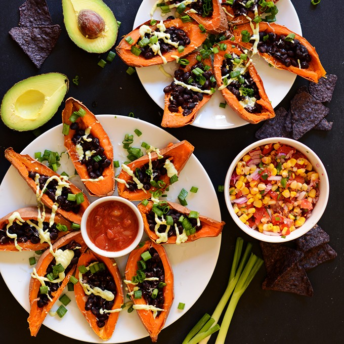 Plates of colorful Loaded Sweet Potato Boats for a delicious vegan meal