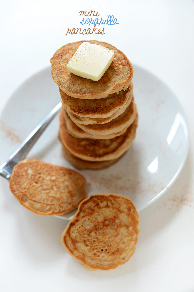 Giant stack of Mini Sopapilla Pancakes topped with butter