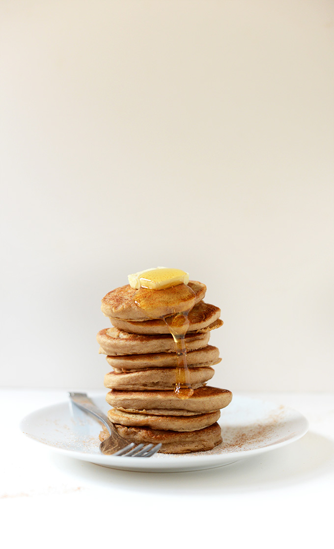 Stack of Mini Sopapilla Pancakes with butter and honey on top
