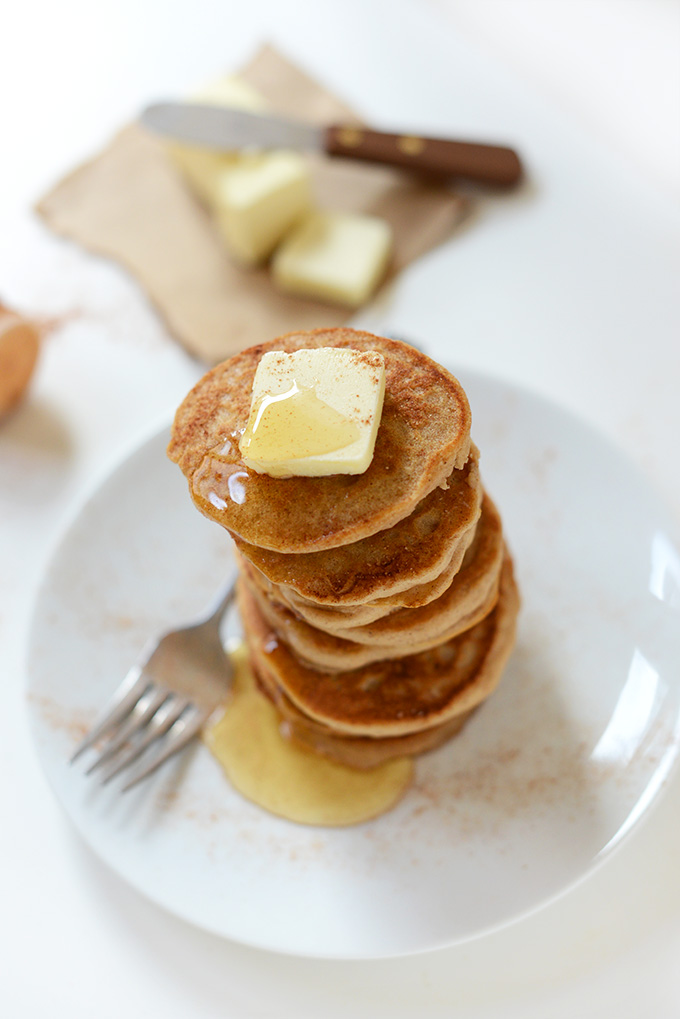 Stack of Sopapilla Pancakes with honey and slabs of vegan butter in the background