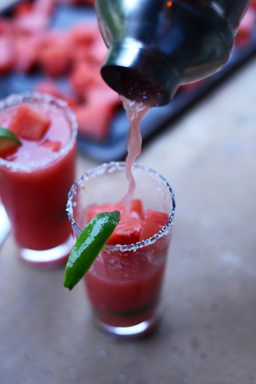 Pouring a Watermelon Lime Margarita for a refreshing homemade drink
