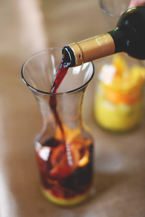 Pouring wine into a jug to make our Spanish Sangria recipe