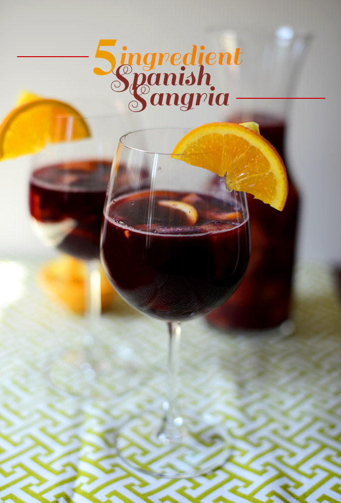 Pitcher and wine glasses filled with a batch of our Spanish Sangria recipe