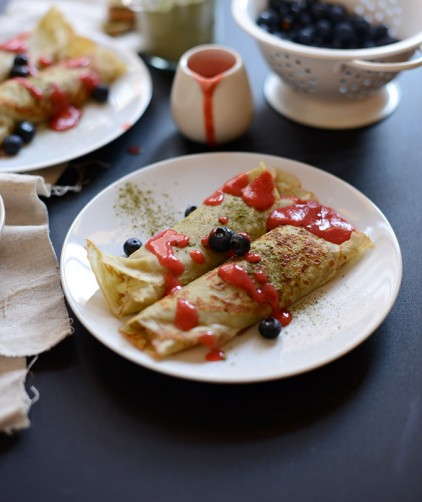 Plate of our Gluten-Free Green Tea Crepes recipe drizzled with fresh berries