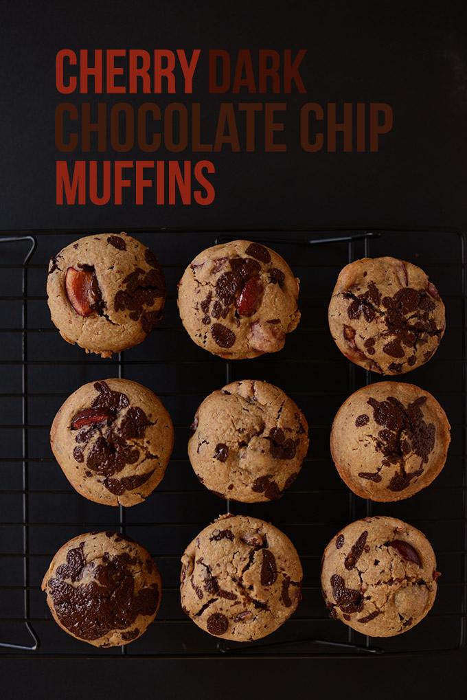 Batch of vegan Cherry Dark Chocolate Chip Muffins on a cooling rack