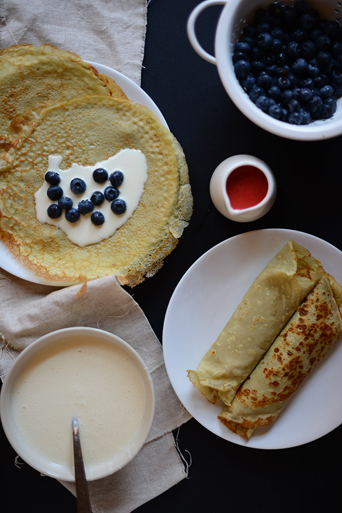 Gluten-Free Green Tea Crepes filled with White Chocolate Coconut Filling and fresh blueberries