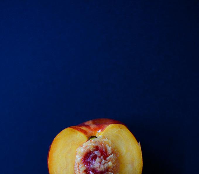 Halved fresh nectarine for making a homemade crisp