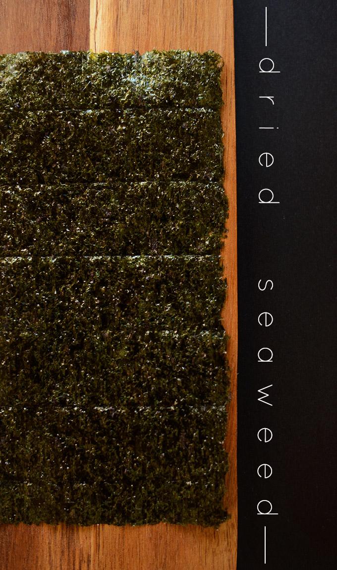 Sheet of Nori Seaweed on a wood cutting board