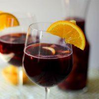 Wine glasses of Spanish Sangria with orange slices on the rims