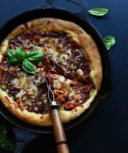 Skillet filled with a batch of our Deep Dish Pizza recipe
