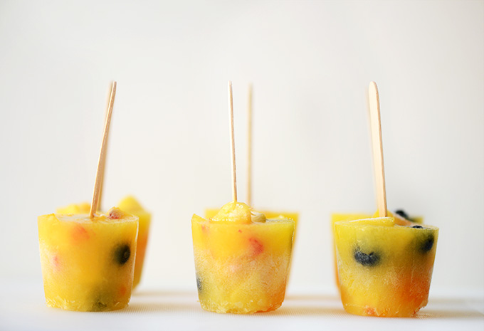 Side view of a batch of our homemade fruit popsicles
