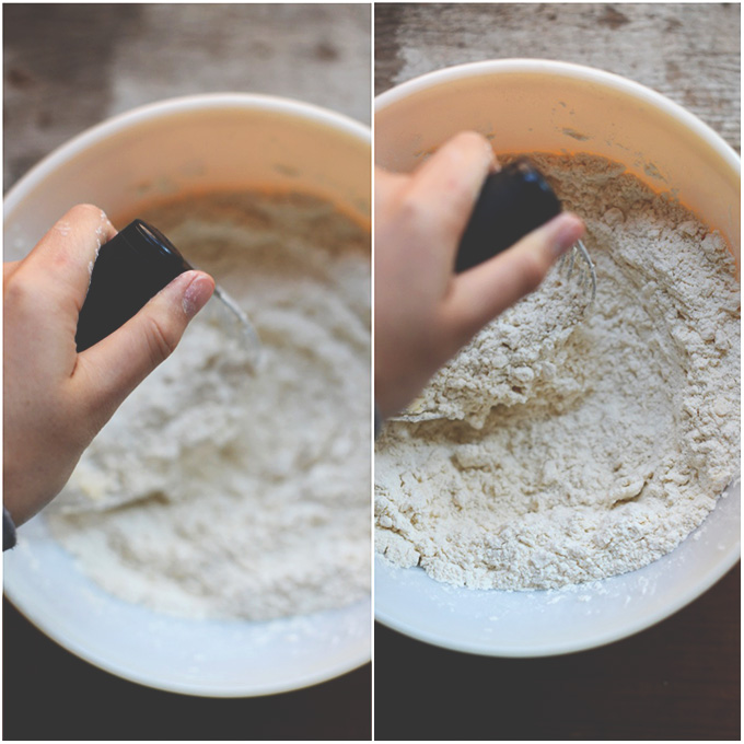 Using a pastry cutter to mix vegan butter and flour