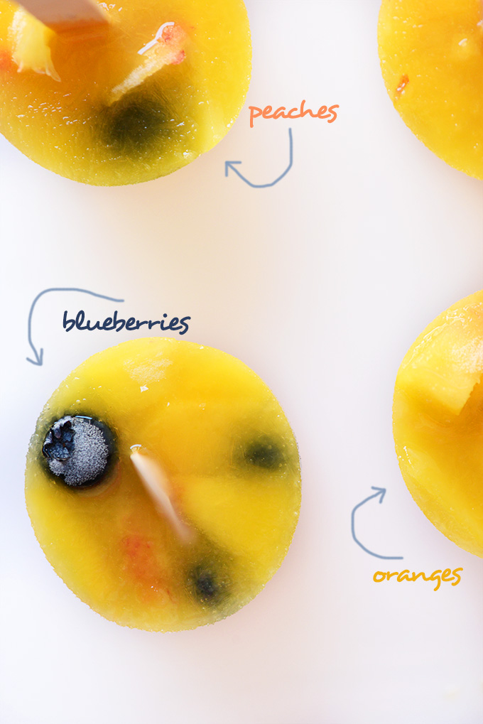 Showing blueberries, peaches, and oranges in our fresh fruit popsicles