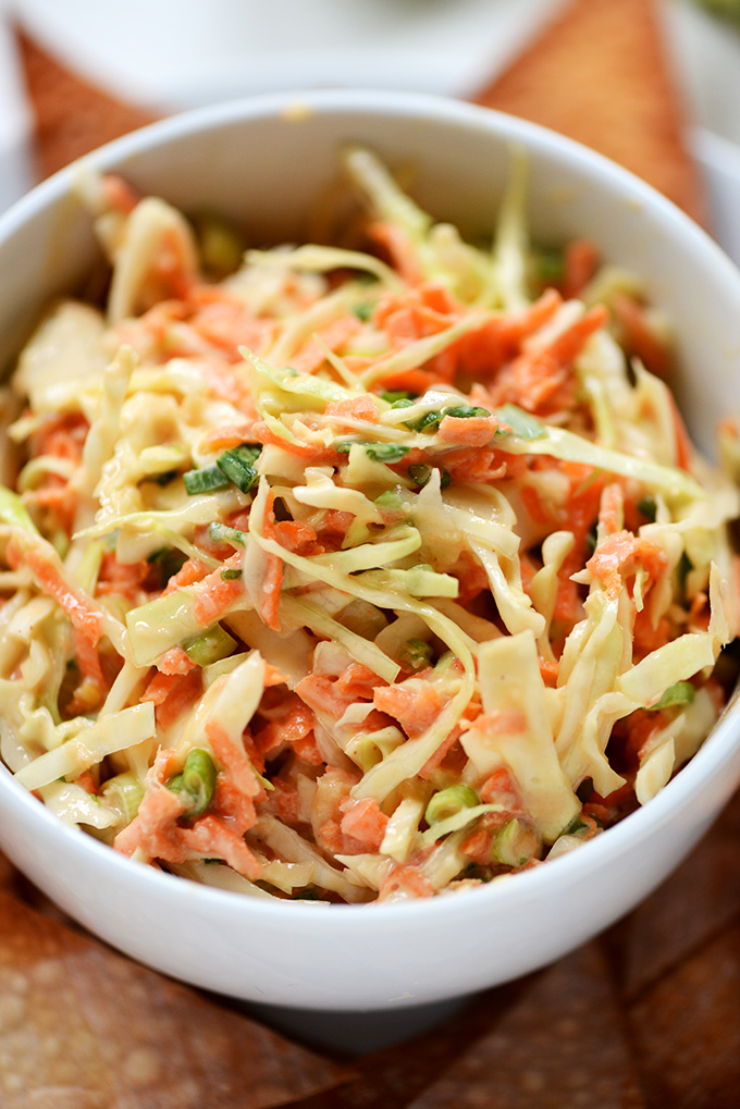 Close up shot of a small bowl of our delicious Creamy Thai Slaw recipe