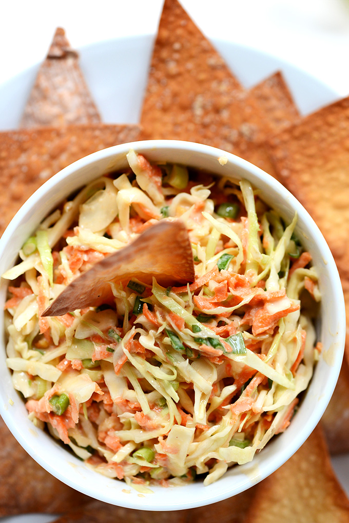 Bowl of Creamy Thai Slaw with wonton chips