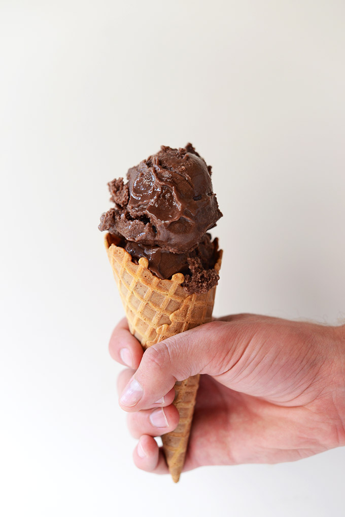 Holding a cone filled with Dairy-Free Chocolate Ice Cream