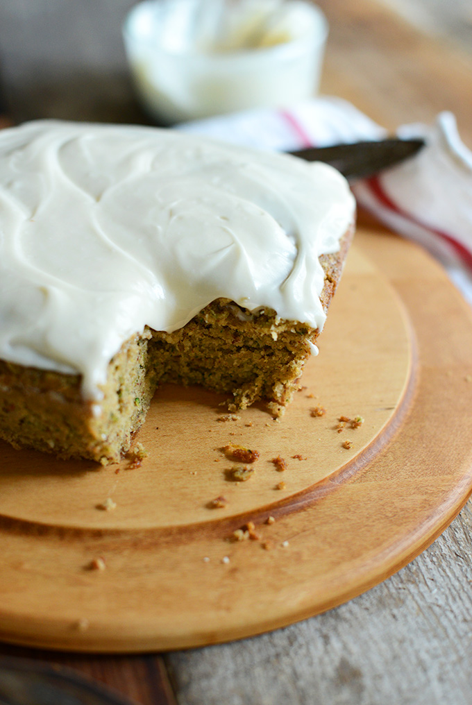 Loaf of Gluten-Free Zucchini cake topped with Dairy-Free Frosting
