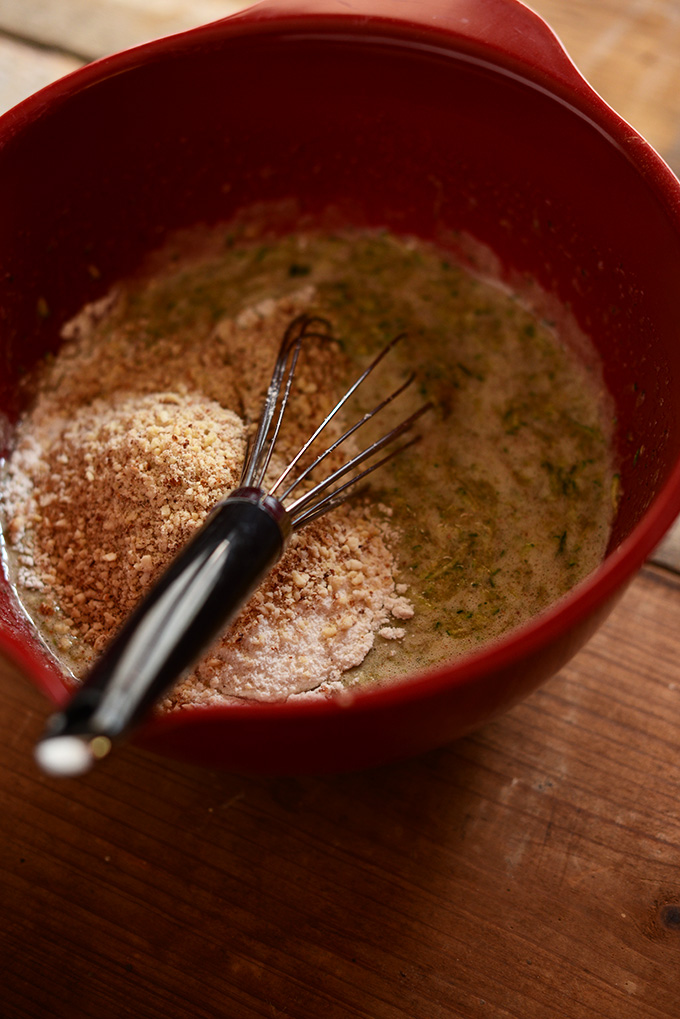Using a whisk to mix together batter for Gluten-Free Zucchini Cake