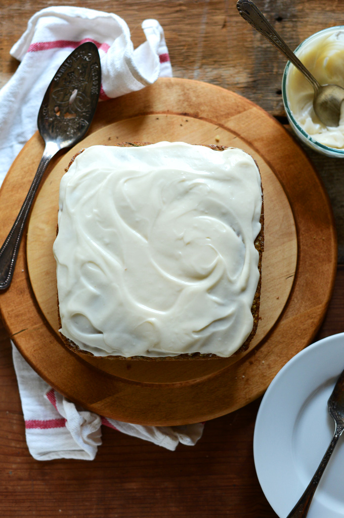 Cutting board with a loaf of Gluten-Free and Dairy-Free Zucchini Cake