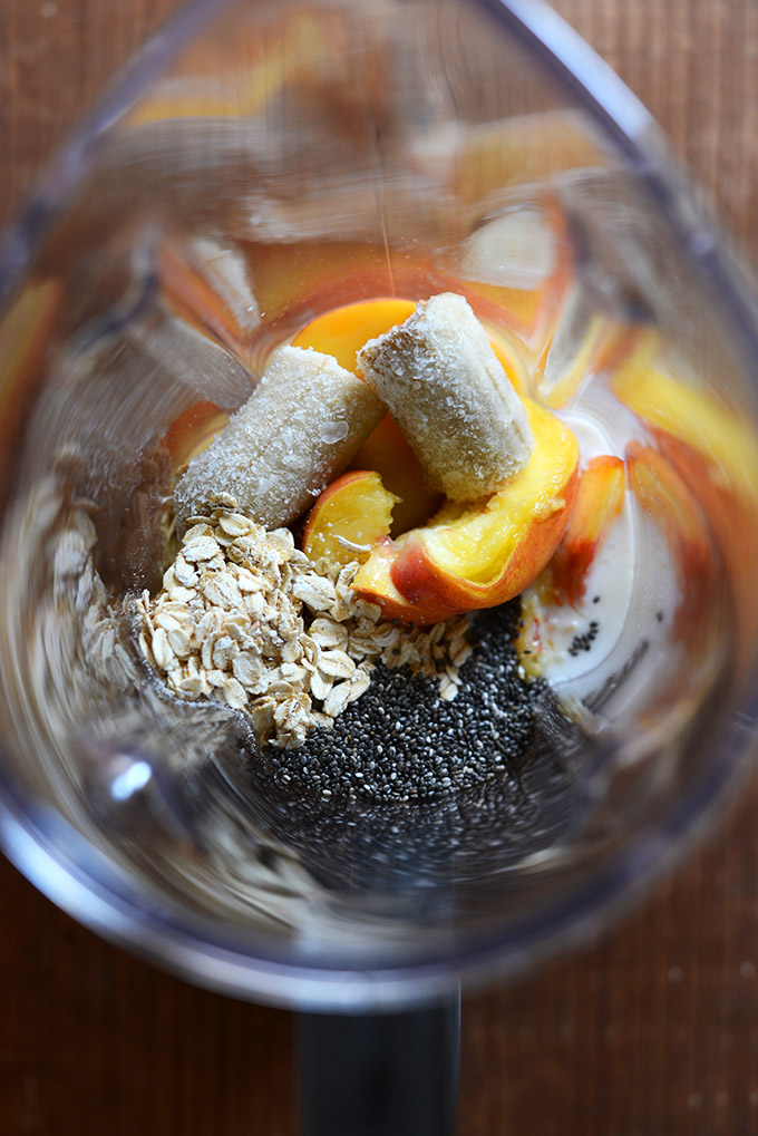 Blender with ingredients for making our Peach Oat Chia Smoothie recipe