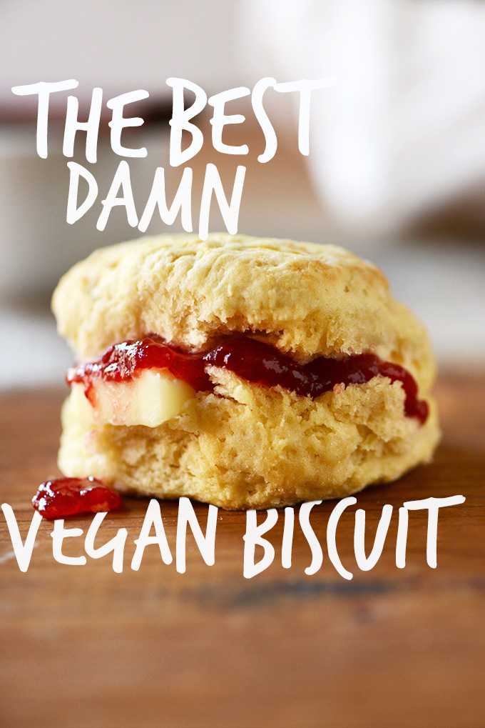 Vegan biscuit sliced open with jam and vegan butter inside