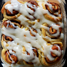 Pan of the World's Easiest homemade Cinnamon Rolls drizzled with icing