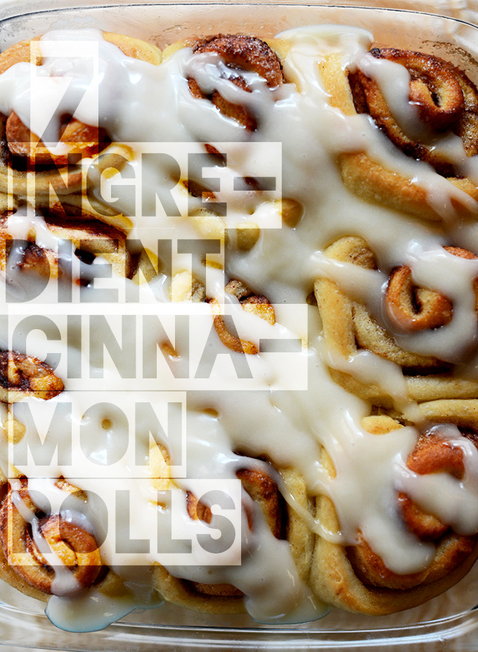 Pan with a batch of Vegan Cinnamon Rolls topped with icing
