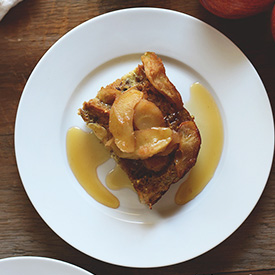 Plate with a slice of Apple French Toast Baked and maple syrup